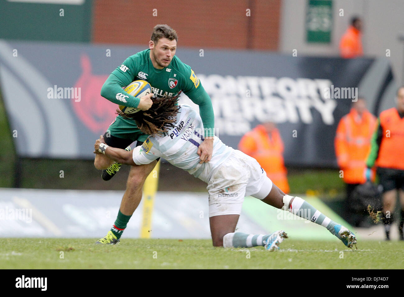 Leicester, UK. 23rd Nov, 2013. Niall Morris of Leicester Tigers is tackled by Marland Yarde of London Irish during - Stock Image
