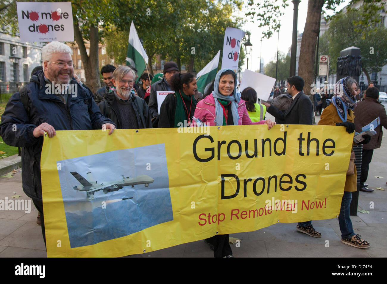 London, November 23rd 2011. Chris Cole , left, of Drone Wars UK helps carry a banner during a march from Downing Stock Photo