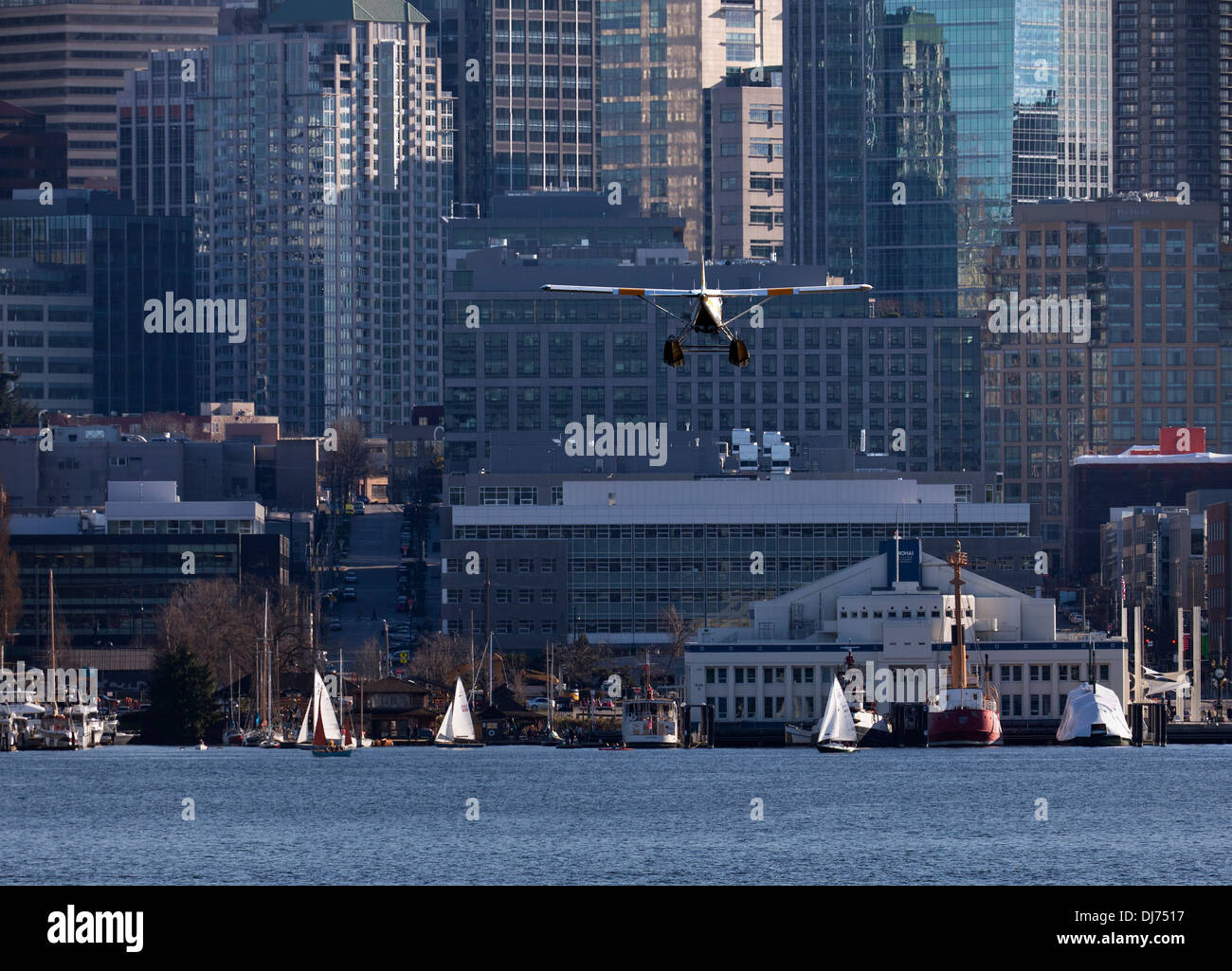 WASHINGTON - Kenmore Air seaplane on landing approach to Lake Union in Seattle. - Stock Image