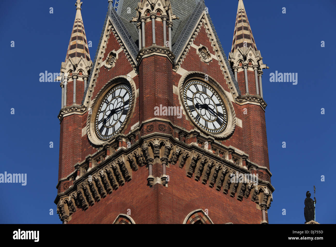 The grand clock tower of Saint Pancras Railway station in London. Showing two faces of the clock . - Stock Image