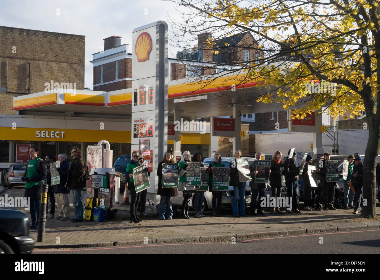 Islington, London, UK. 23rd Nov, 2013. Greenpeace campaigners gather outside Shell Petrol Station in Upper Street Islington to take part in a Free The Arctic 30 Protest. 28 Greenpeace activists have been released on bail from a Russian prison where they were being held on charges of piracy and hooliganism. Credit:  Andrea Heselton/Alamy Live News - Stock Image