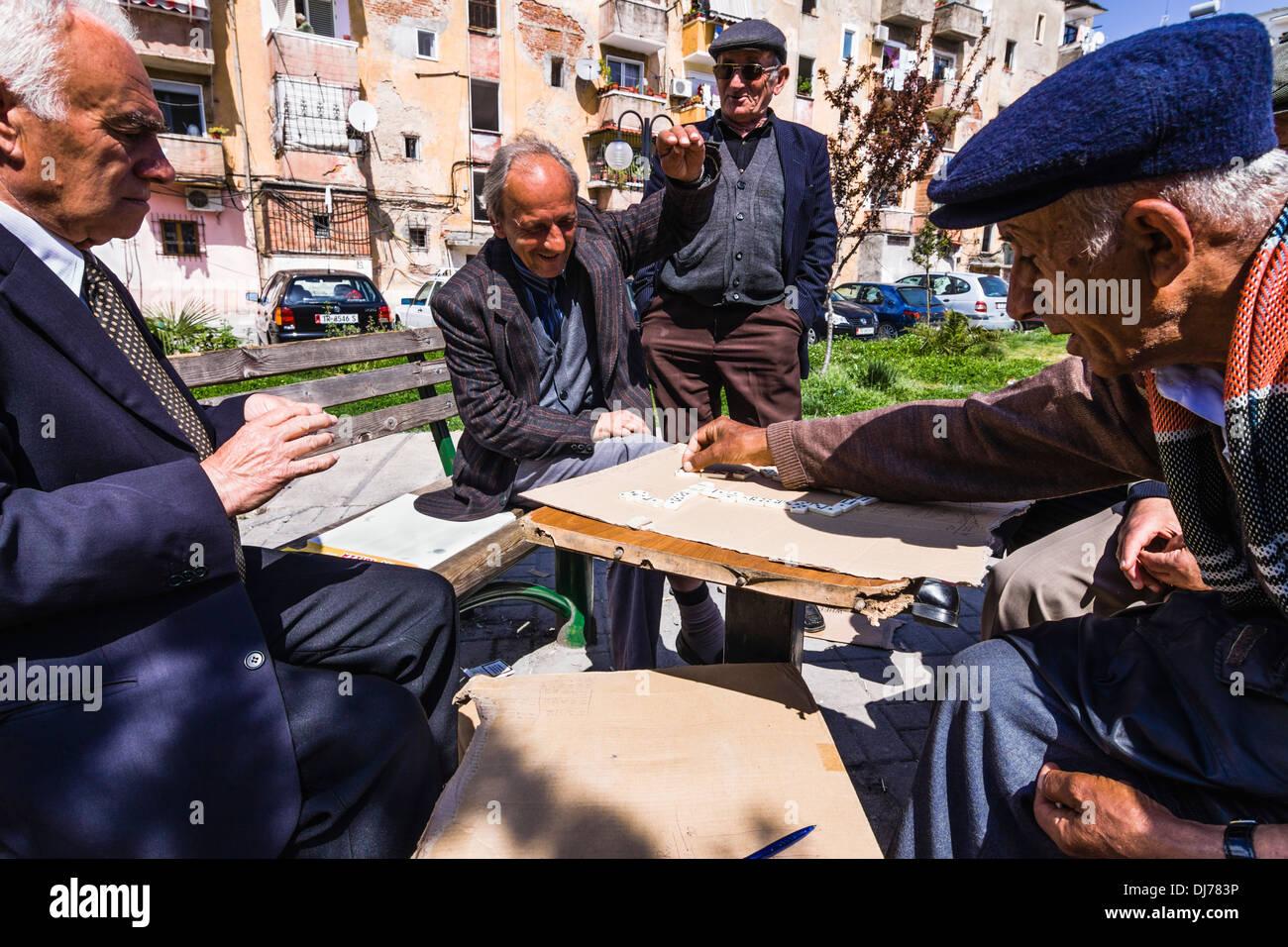 Old men playing domino in the street. Tirana, Albania - Stock Image