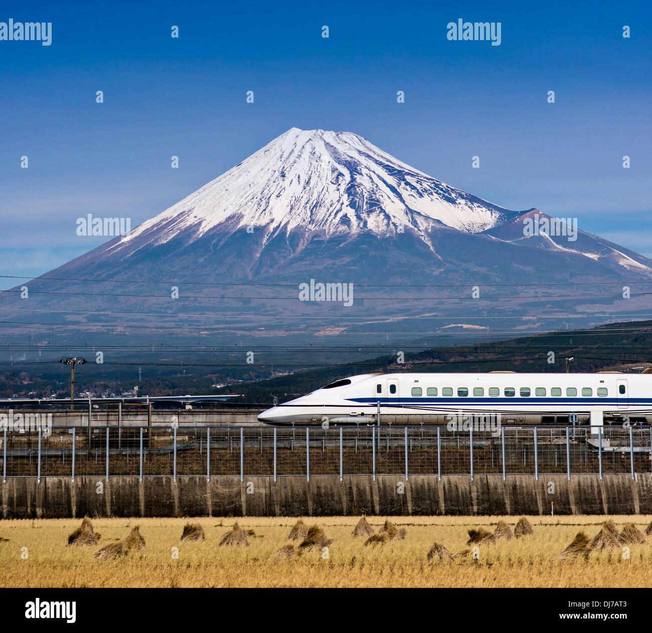Bullet train passes below Mt. Fuji in Japan Stock Photo