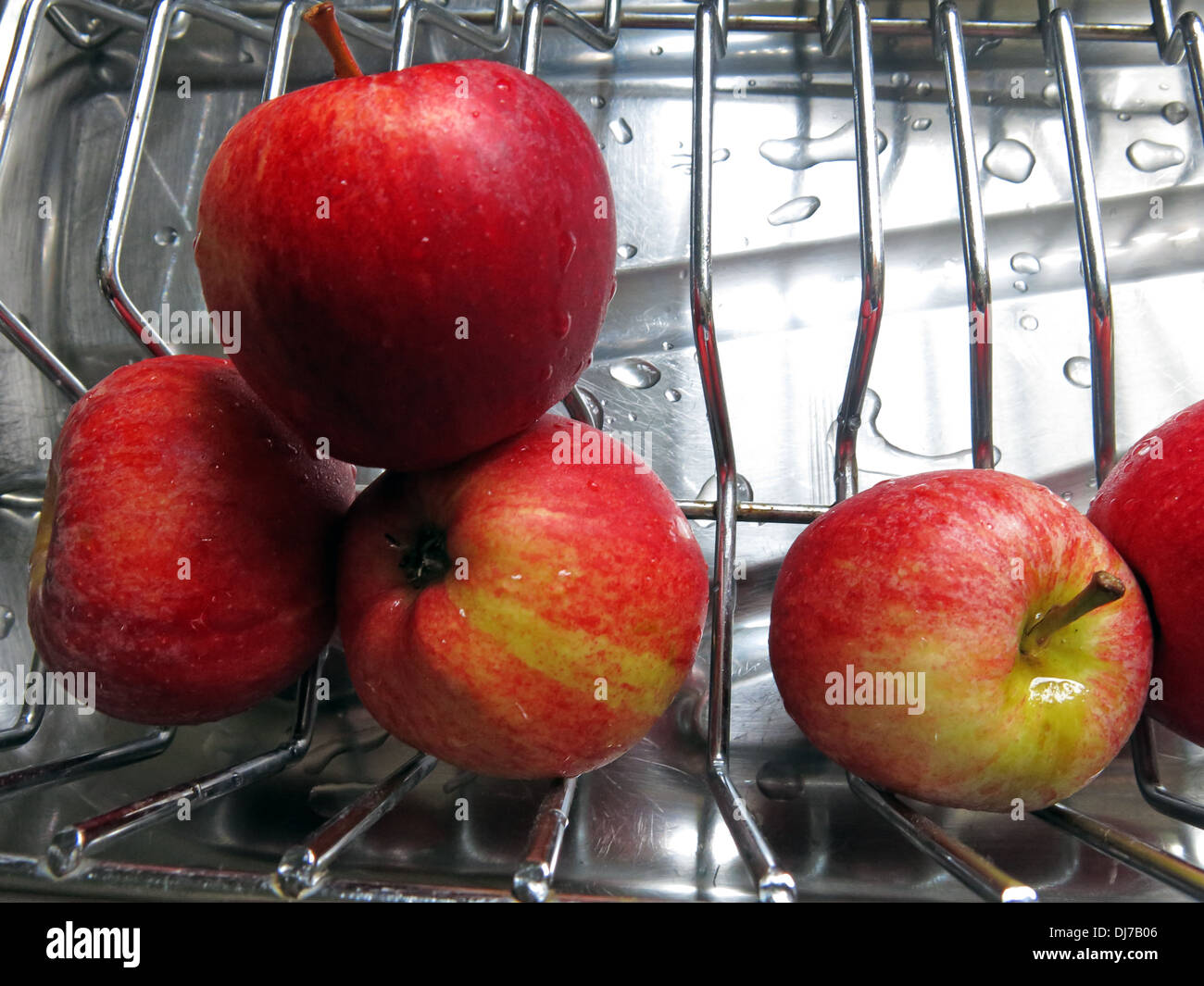 Health freshly washed red apples on a drainer An Apple A Day keeps the Doctor Away - Stock Image