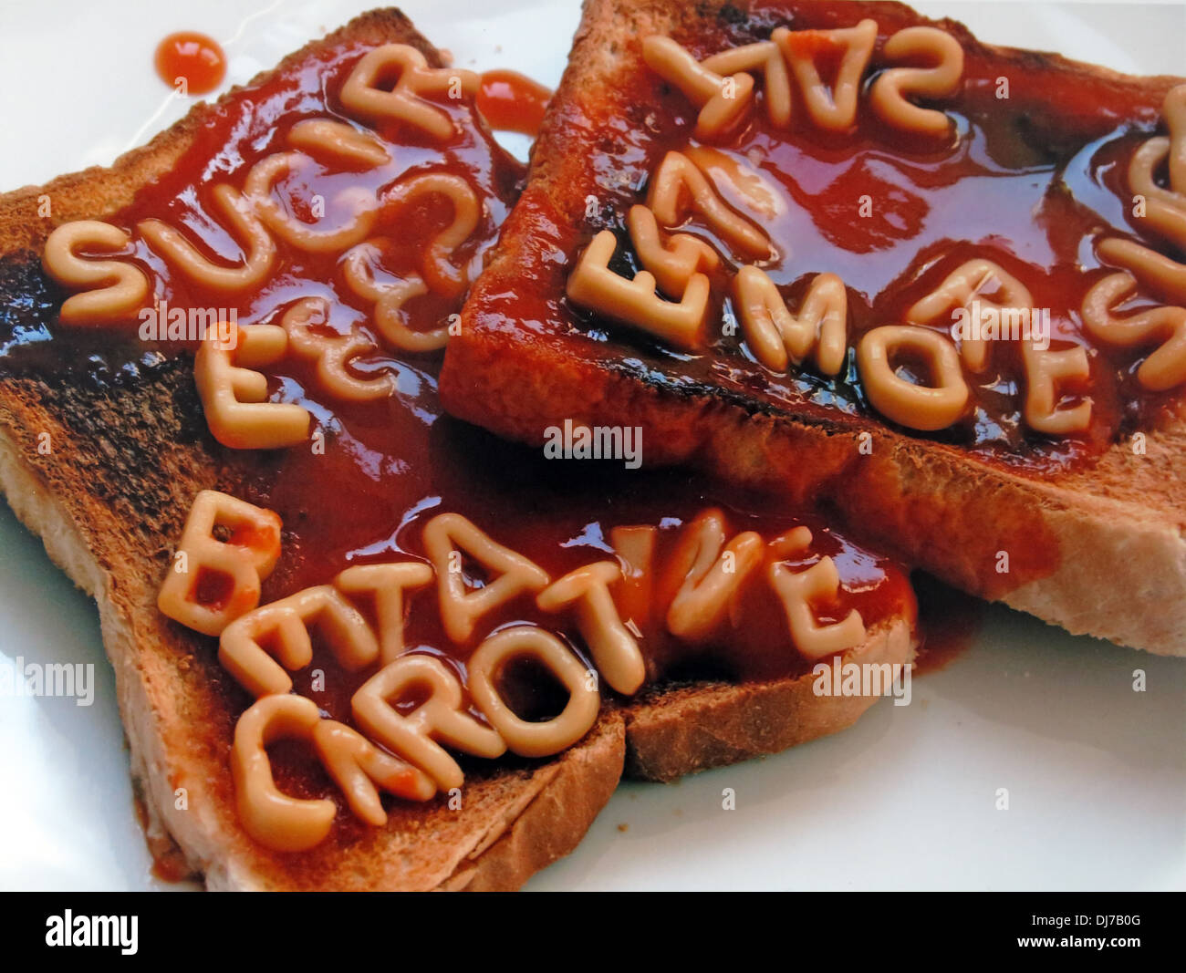Unhealthy additives in our food spelt out in alphagetti spaghetti on toast - Stock Image