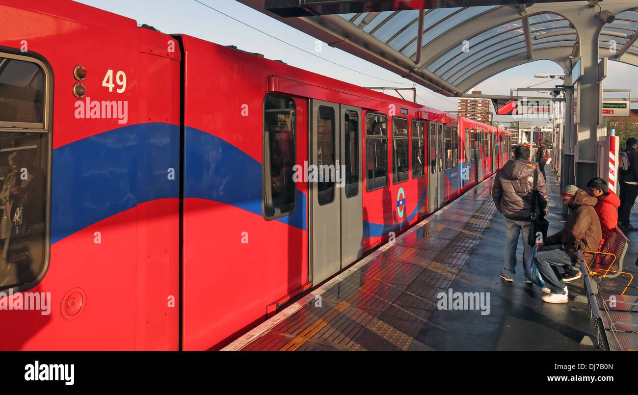 Red train at Shadwell DLR station East London England UK - Stock Image