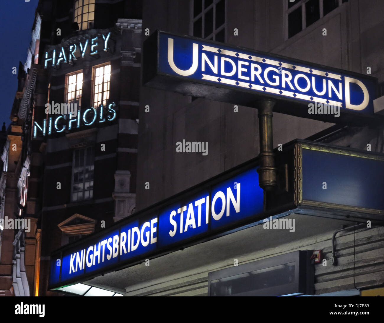 Harvey Nichols and Knightsbridge underground station London at Dusk England UK - Stock Image