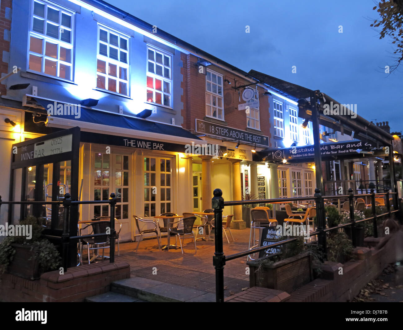 Wine bars Restaurants Stockton Heath Warrington at dusk England UK - Stock Image