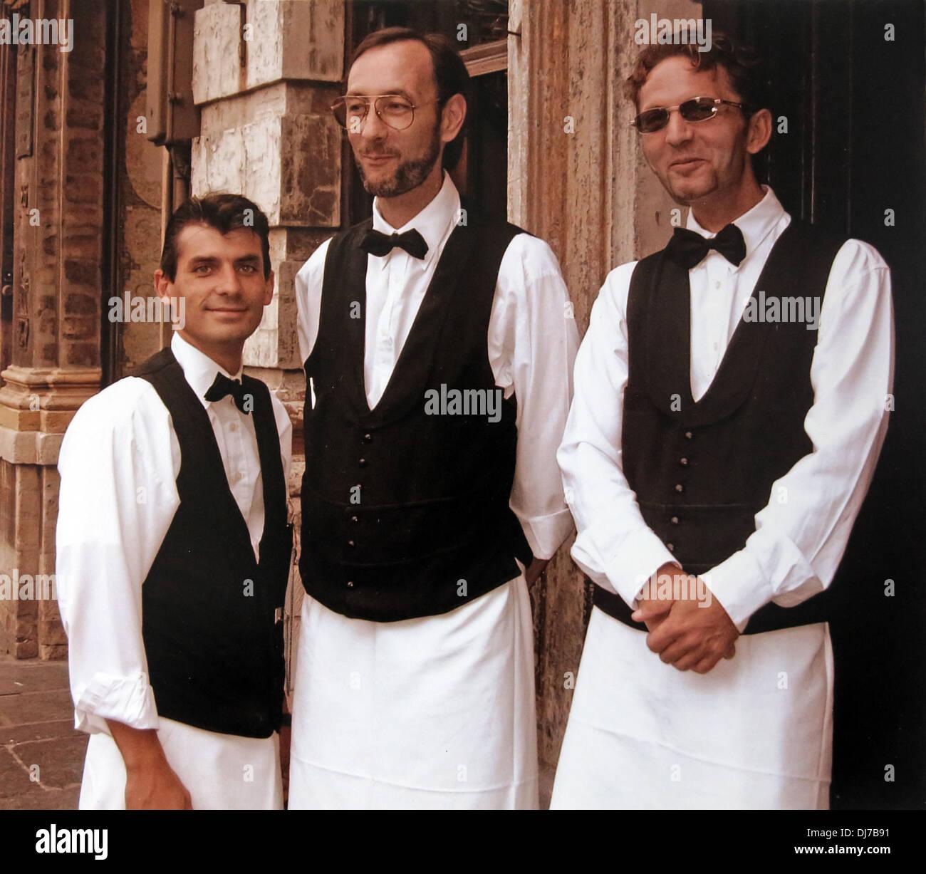Three cool waiters garcons Stock Photo