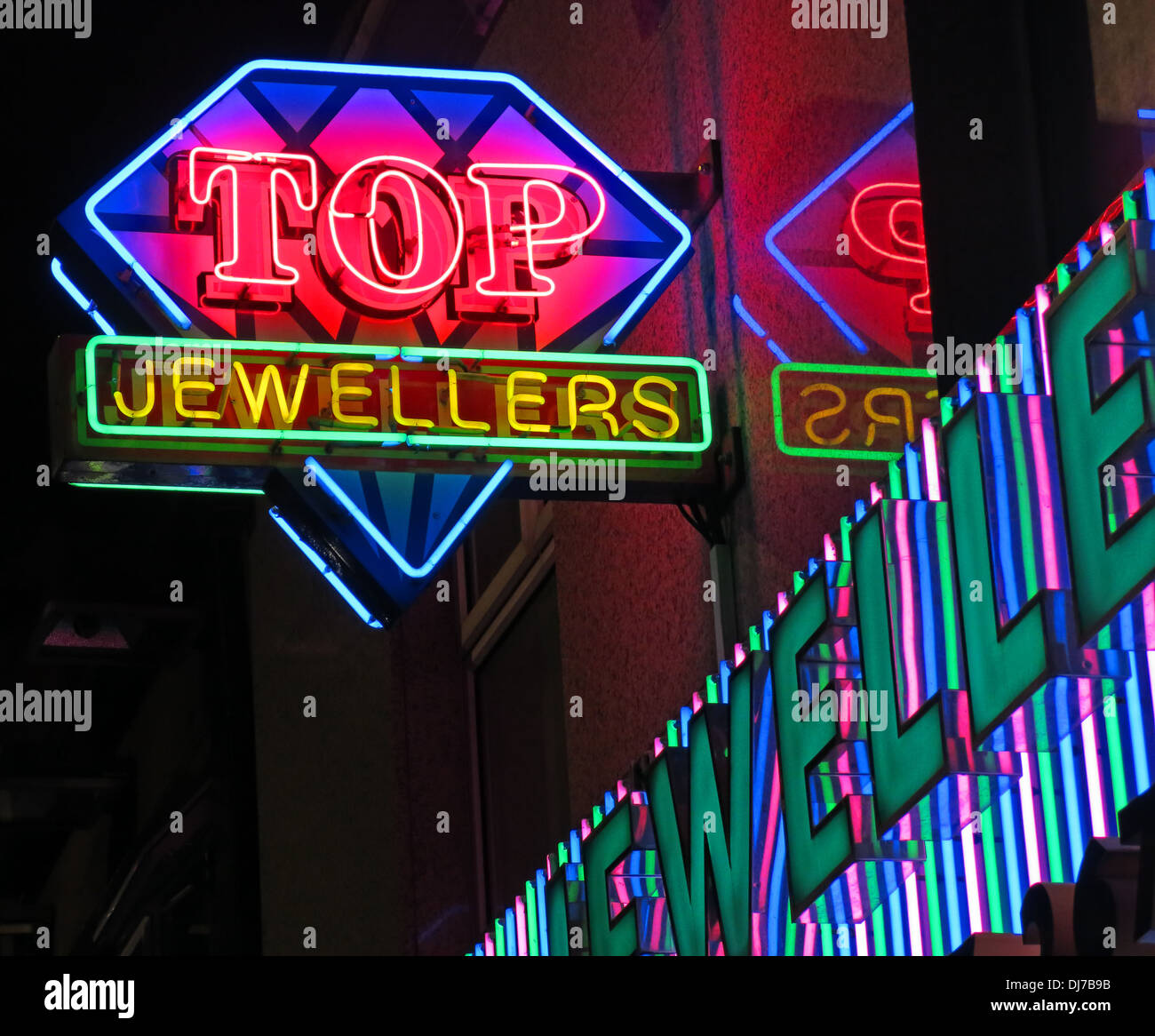 Top Indian Jewelers Rusholme Curry Mile Manchester England UK at night - Stock Image