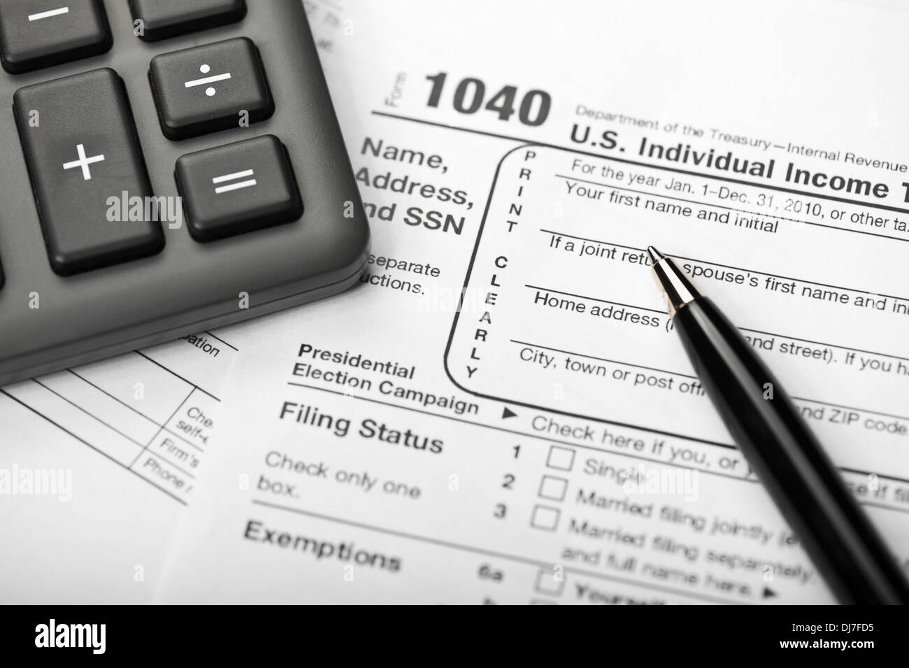 Filling 1040 tax form surrounded other stock photo (edit now.