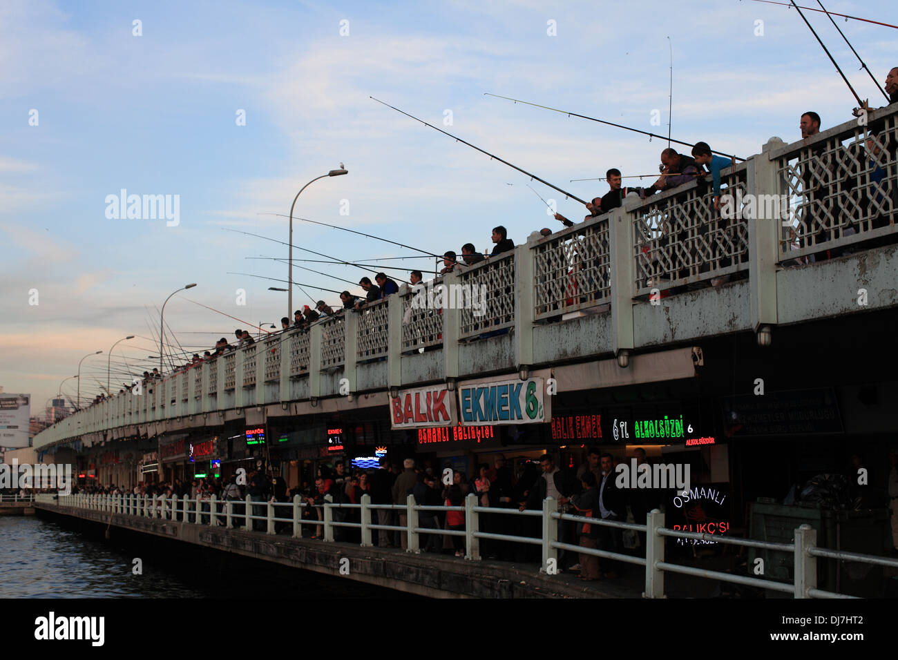 Men fishing from bridge over the Bosphorus in the Golden Horn - Stock Image