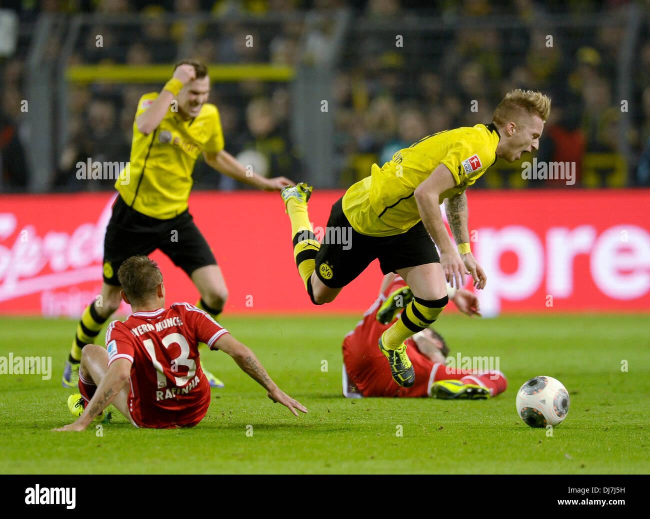 Dortmund, Germany November 23rd 2013, German Football Bundesliga Season 2013/14 matchday 13, Borussia Dortmund (BVB) vs. FC Bayern Munich (Muenchen, Munchen, FCB) 3:0 --- Rafinha (Bayern Muenchen) fouls Marco Reus (BVB) - Stock Image