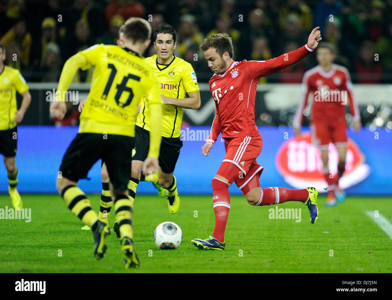 Dortmund, Germany November 23rd 2013, German Football Bundesliga Season 2013/14 matchday 13, Borussia Dortmund (BVB) vs. FC Bayern Munich (Muenchen, Munchen, FCB) 3:0 --- Mario Gštze (Goetze) (Bayern) shoots his goal for the 0:1 - Stock Image