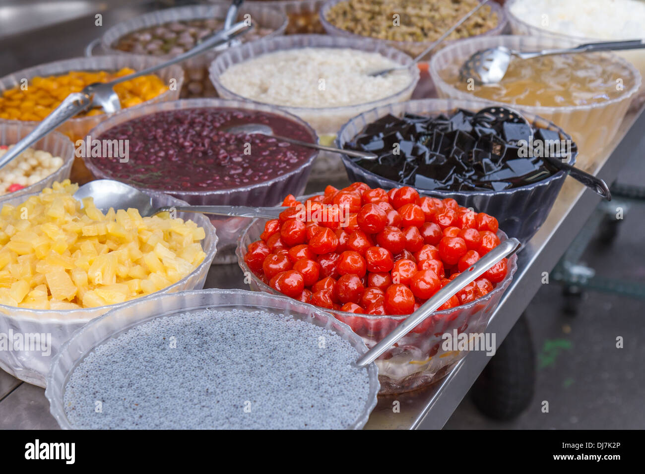 Toppings for Taiwanese shaved ice dessert at a vendor - Stock Image