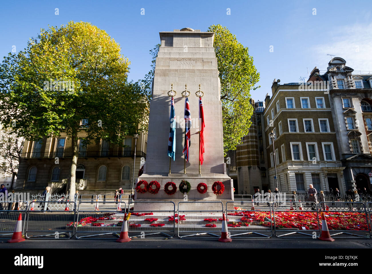 Poppy wreaths laid by the war memorial Cenotaph in Whitehall, London. - Stock Image