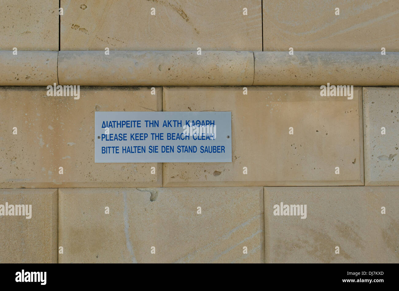 Please Keep The Beach Clean Sign on Wall Stock Photo
