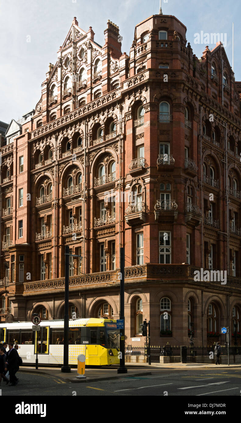 The Midland Hotel with a passing Metrolink tram, Lower Mosley Street, Manchester, England, UK - Stock Image