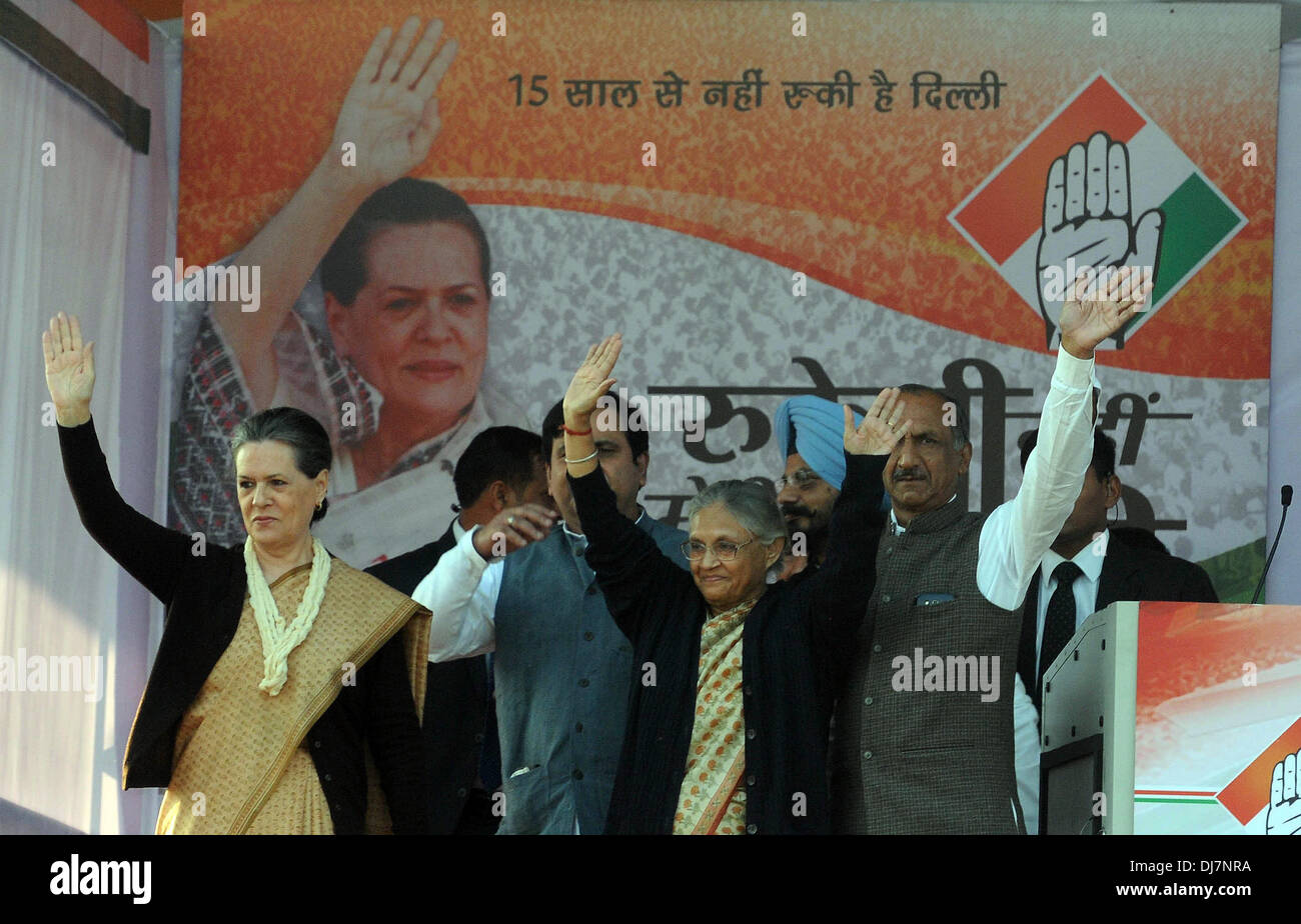 New Delhi, India, 24 Nov 2013.  Indian National Congress Party president Sonia Gandhi (1st L) and Delhi Chief Minister Sheila Dikshit (C, Front) wave to supporters at a public rally ahead of the Delhi state elections at Shastri Park. - Stock Image