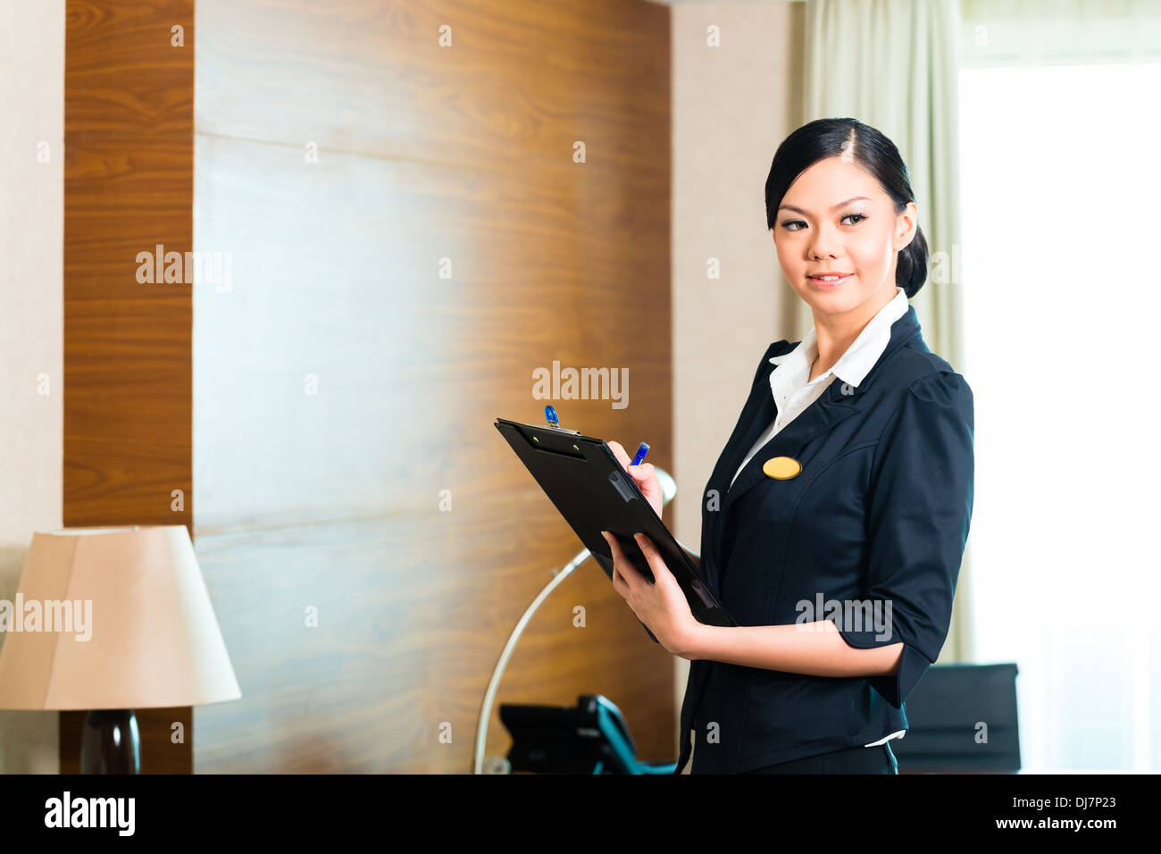 housekeeping manager or assistant controlling or checking the room