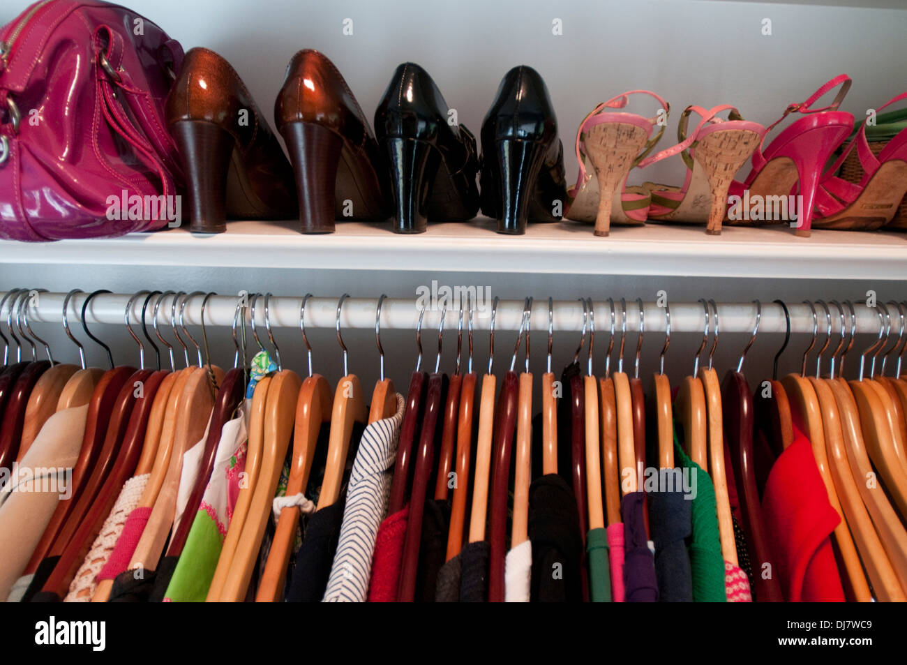 The contents of a woman's closet. - Stock Image