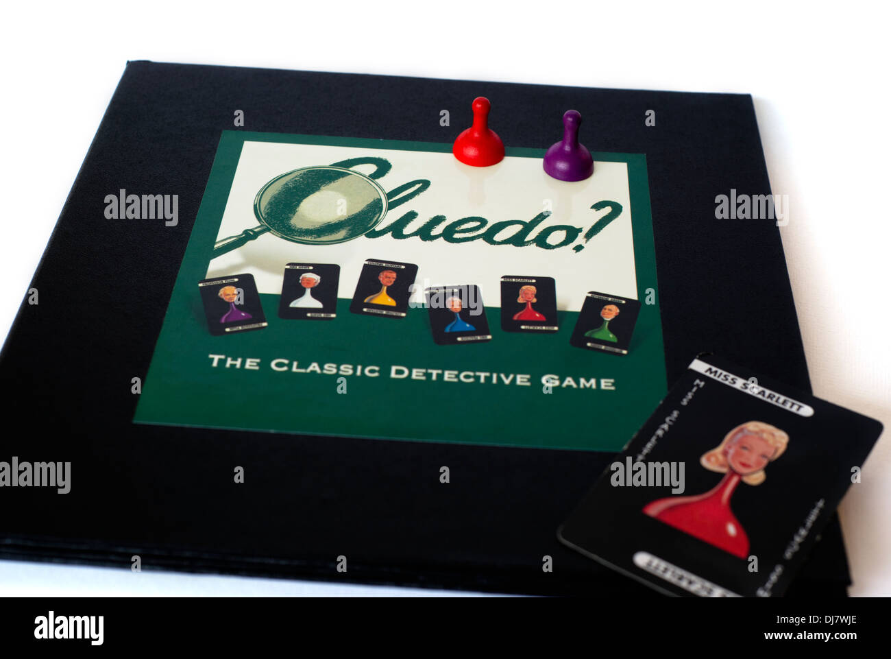 Close-up of the board and some of the pieces of the Cluedo murder mystery board game - Stock Image