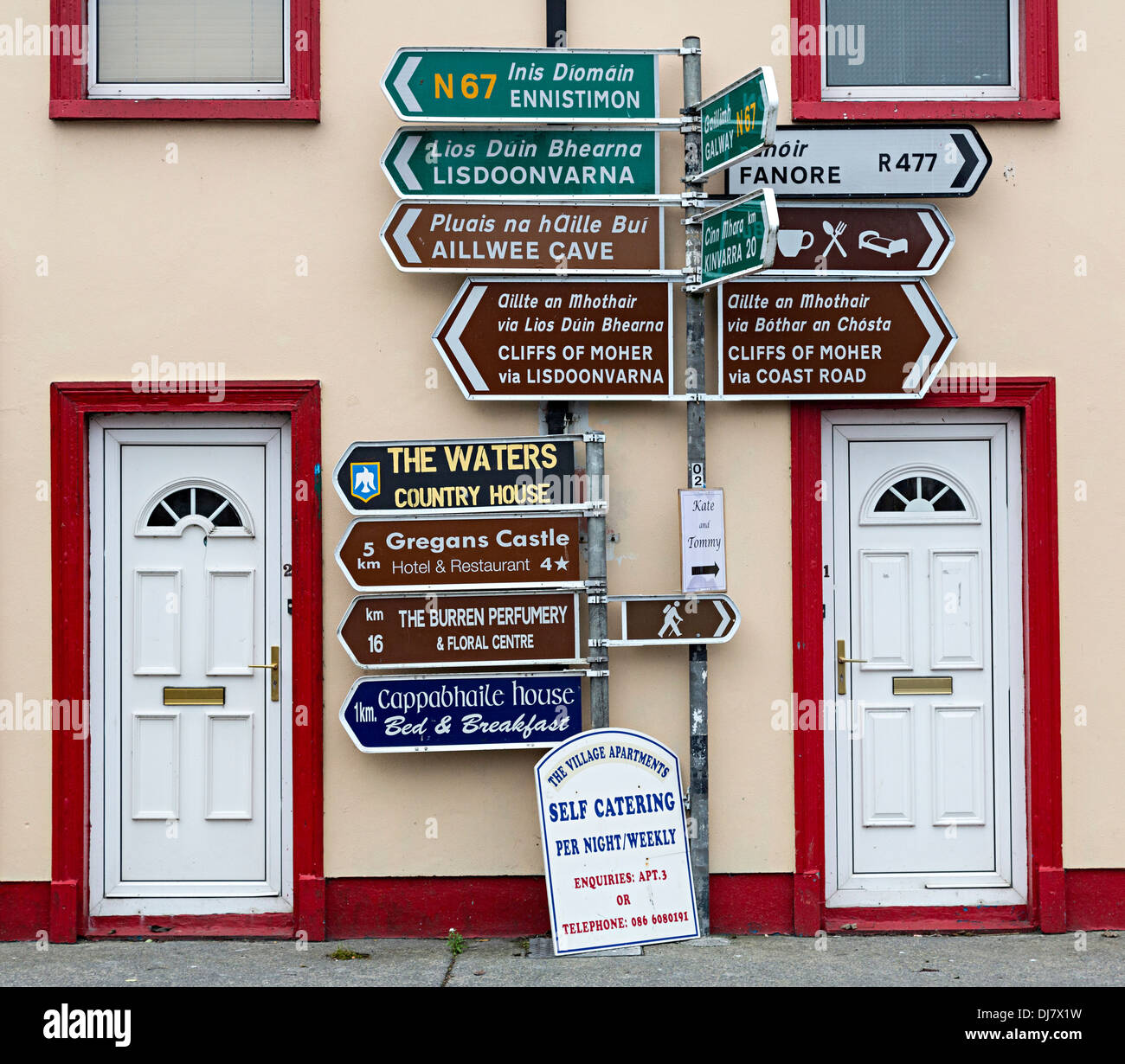 Road signs and doorways, Ballyvaughan, Co. Clare, Ireland - Stock Image