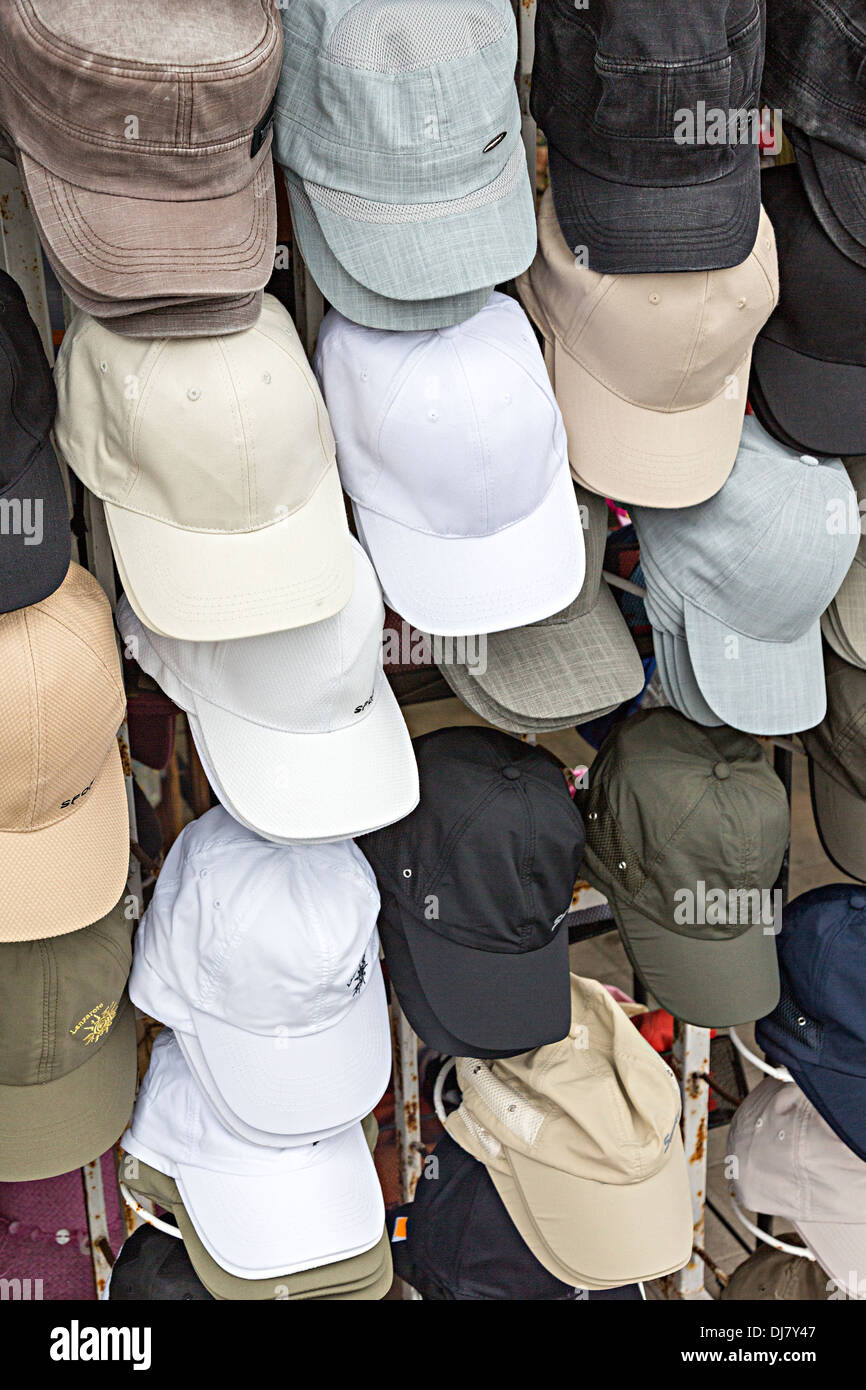 Caps on sale in shop, Costa Teguise, Lanzarote, Canary Islands, Spain - Stock Image