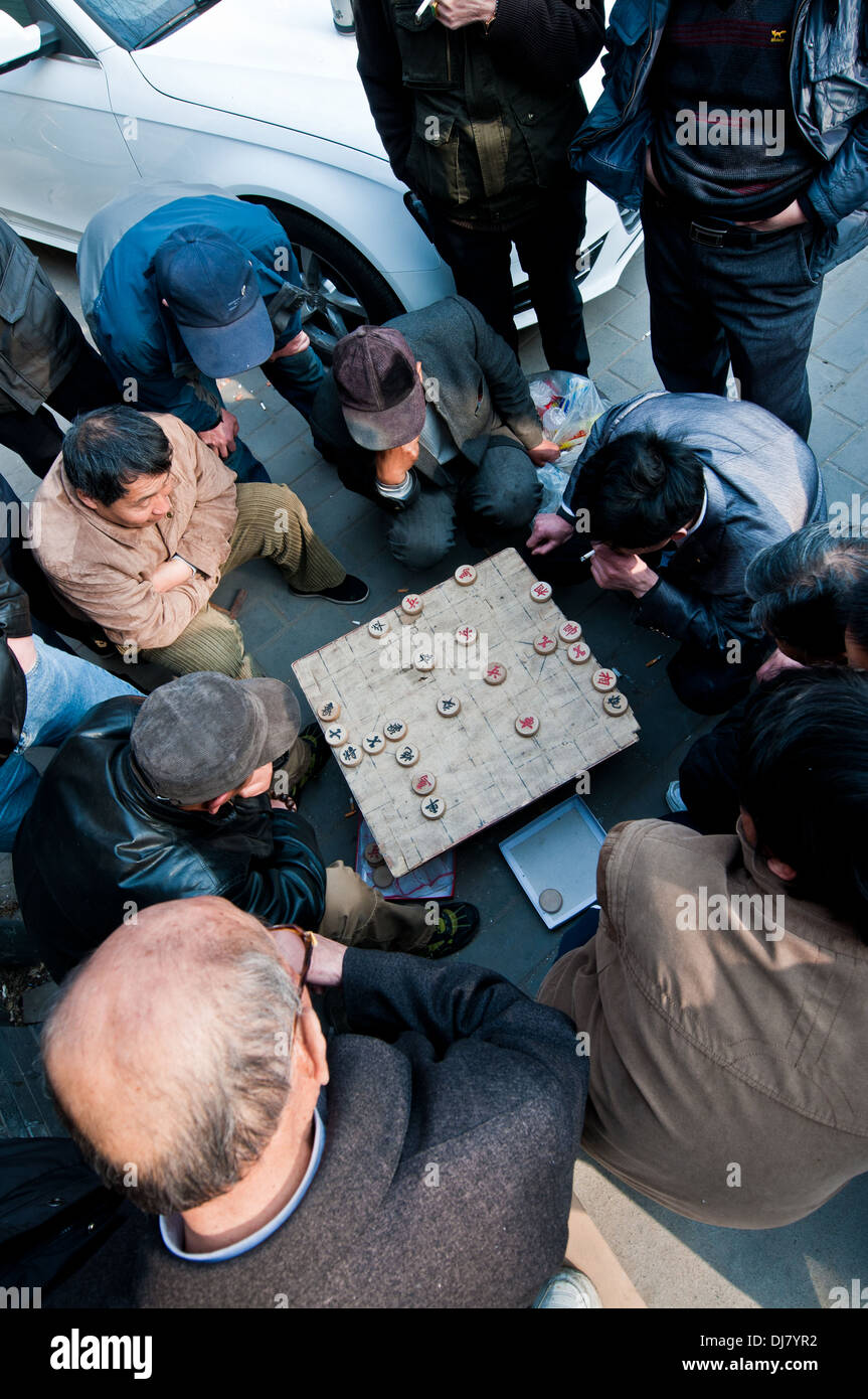 Chinese men playing Xiangqi also called Chinese chess in Beijing, China - Stock Image