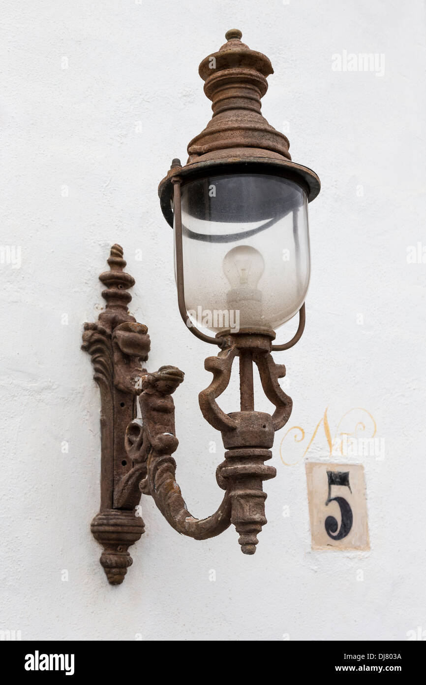 Old ornamental light on bracket with house number, Teguise, Lanzarote, Canary Islands, Spain - Stock Image