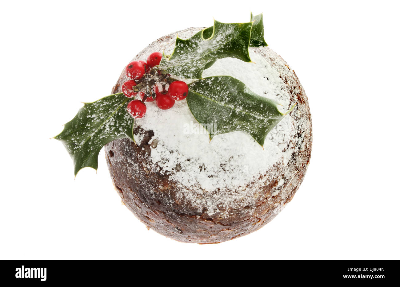 Holly decorated Christmas pudding viewed from above - Stock Image