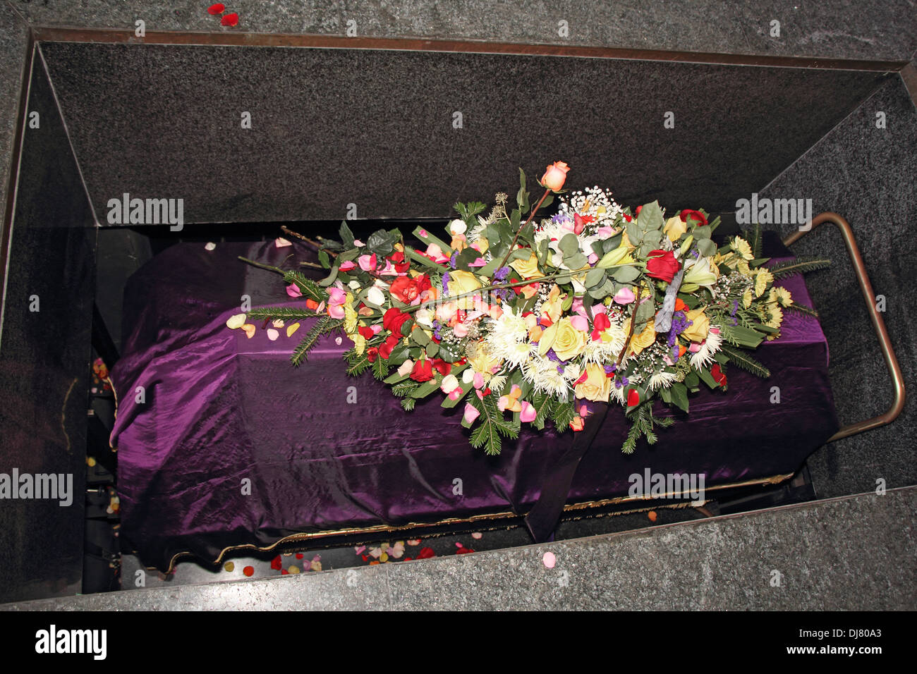 Tomb flower arrangement stock photos tomb flower arrangement stock a coffin in a morgue with a flower arrangement stock image izmirmasajfo