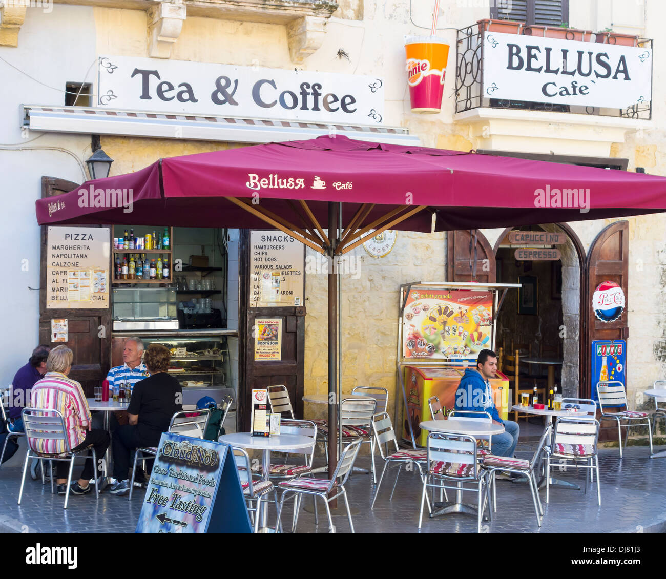 The sights of, overlooking, around and on the Island of Gozo Isle of Calypso Bellusa Cafe shop front canopy shade outside path - Stock Image