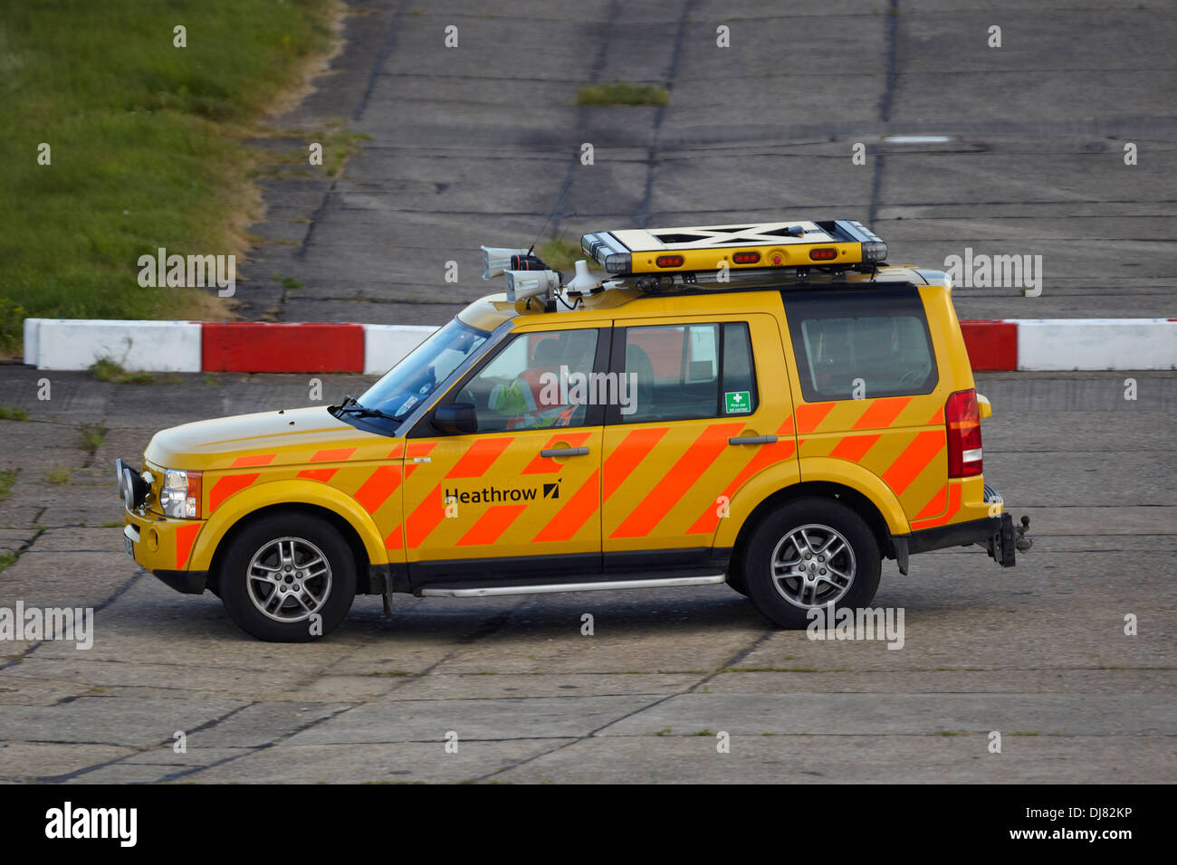 Heathrow Airport  airside operations vehicle on the northern runway - Stock Image
