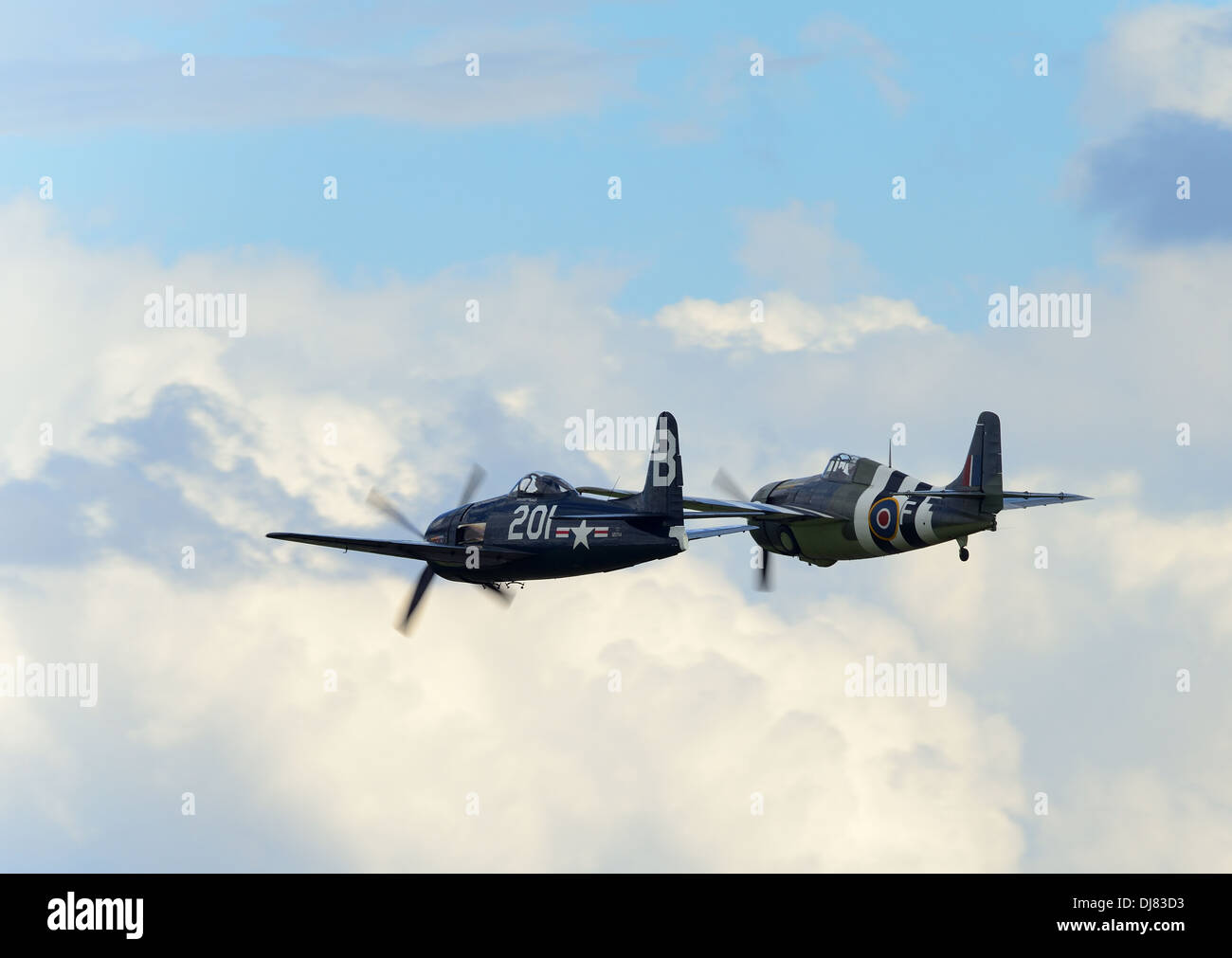 Gruman Bearcat and Wildcat. WW2 fighter planes flying in extremely close formation at Duxford air show. UK 2013 - Stock Image
