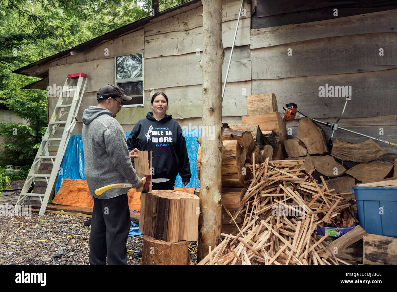 Chopping up cedar for kindling, Cetacea Lab, Gil Island, mid-coast British Columbia - Stock Image