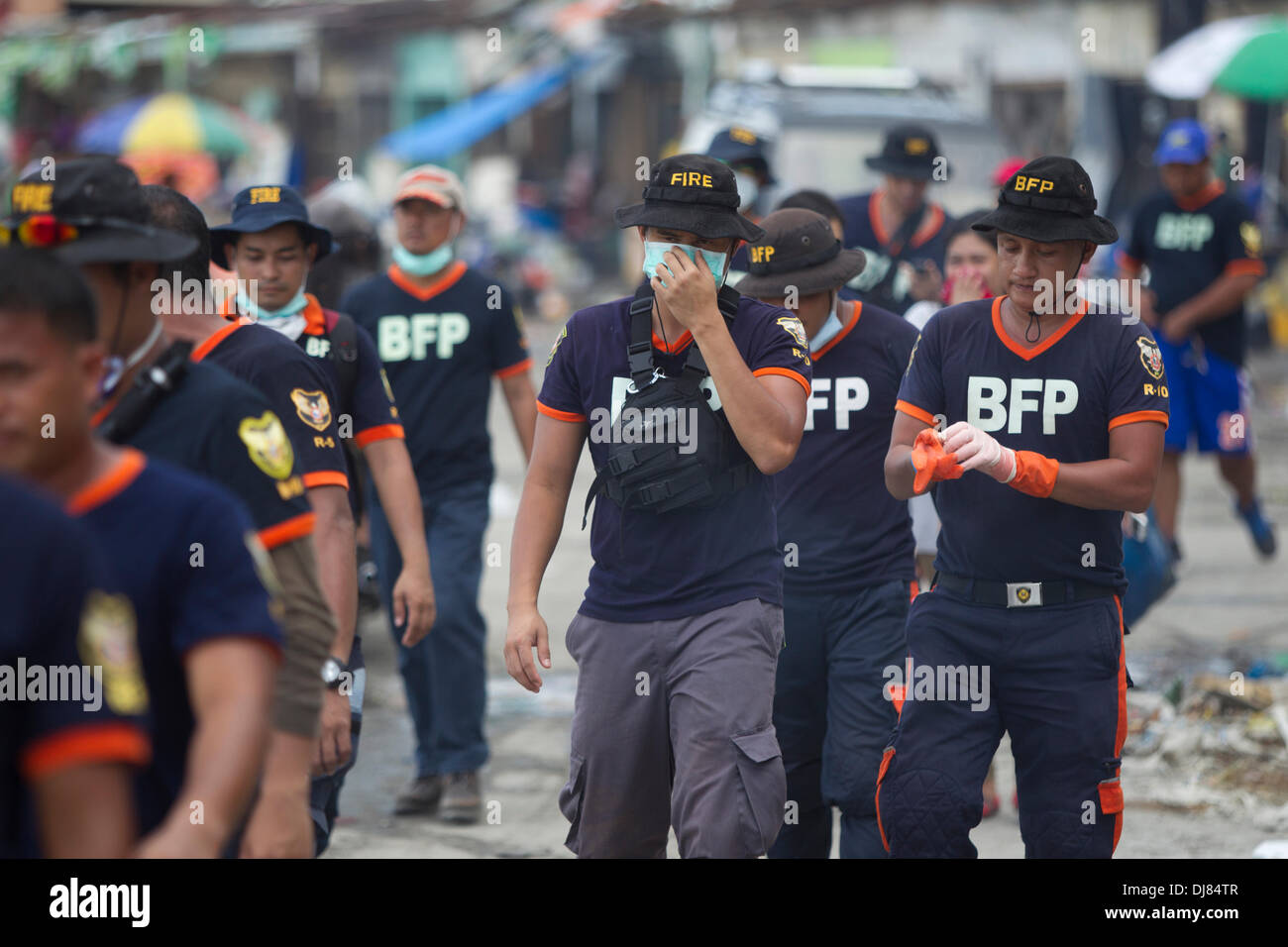 Tacloban City, Phillipines. 21st Nov, 2013. Members of the BFP,(Bureau of Fire Protection) have the unenviable task of assisting in collecting the bodies of the dead.Units have been drafted in from different areas of the Philippines. Credit:  imagegallery2/Alamy Live News - Stock Image
