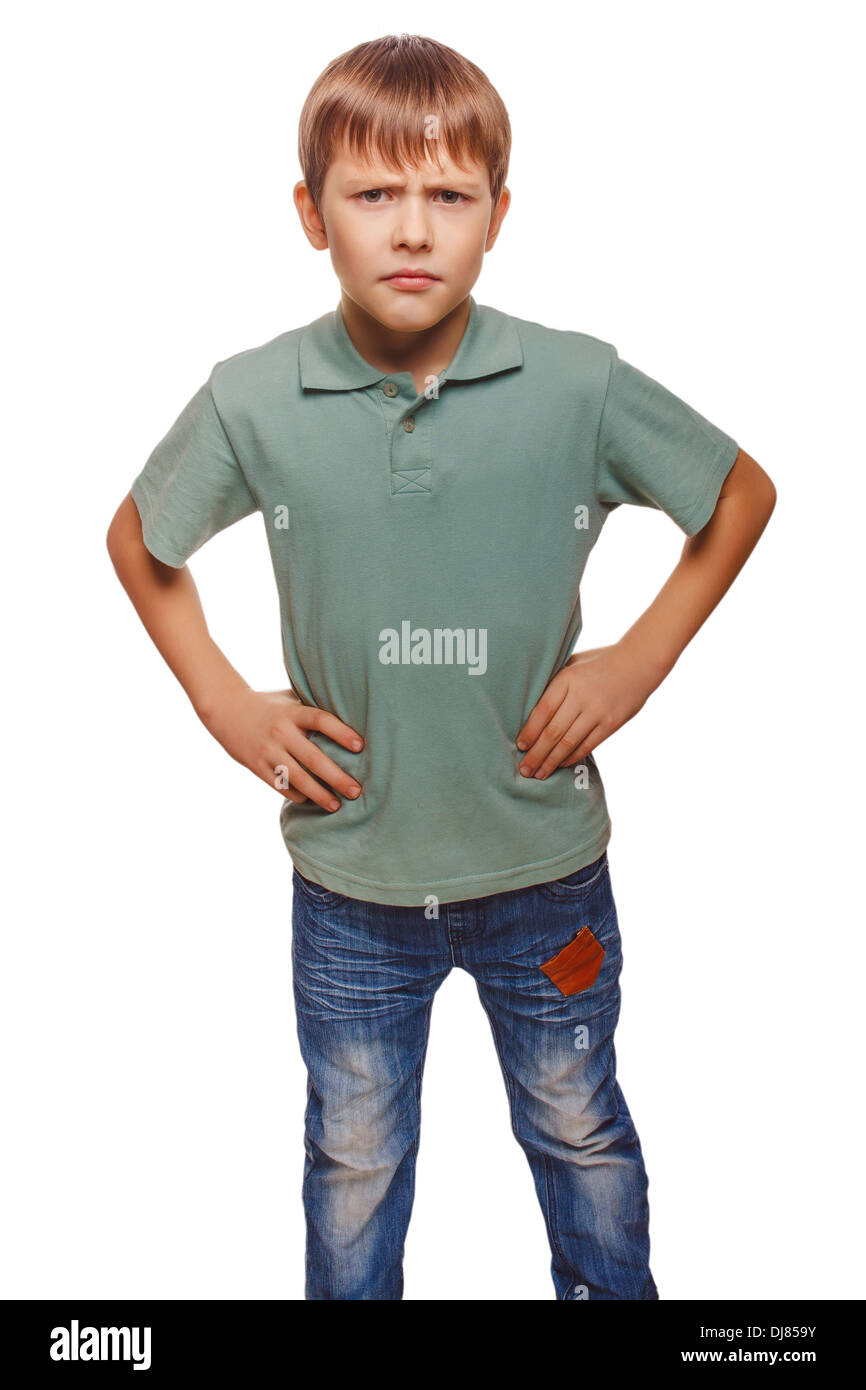 angry teen disgruntled teenager boy frowning isolated on white background - Stock Image