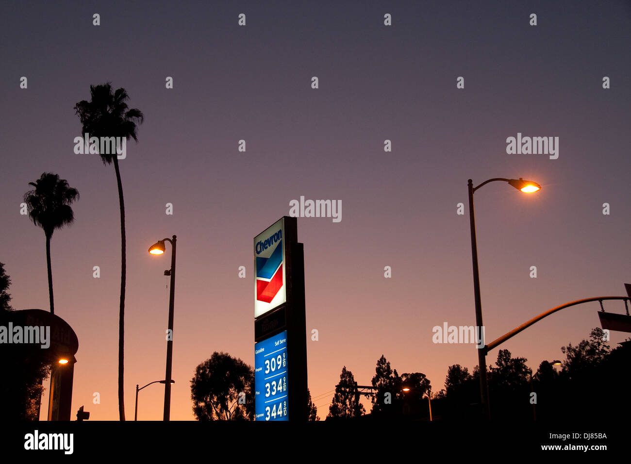 Gas Station sign palm trees street lights at sunset in Los Angeles CA USA & Gas Station sign palm trees street lights at sunset in Los Angeles ...