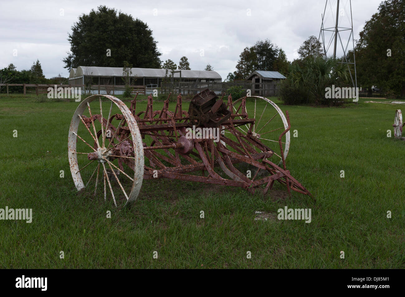 An antique farm plowing attachment sitting in a  pasture Clermont, Florida USA - Stock Image