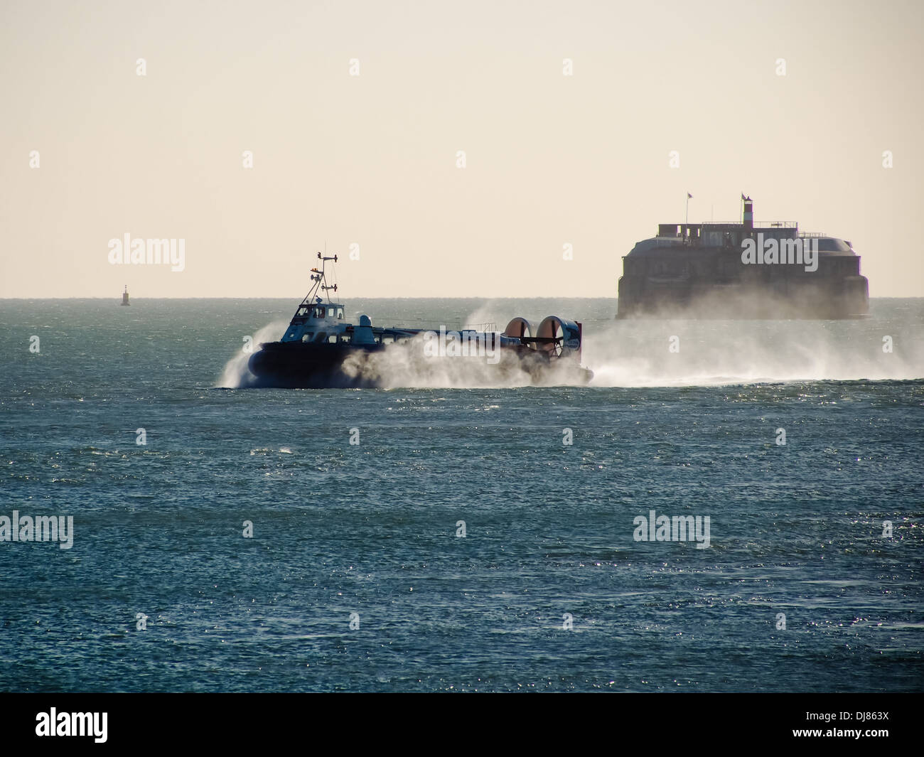 The Portsmouth to Isle of wight Hovercraft crossing the Solent with Spitbank fort in the background - Stock Image