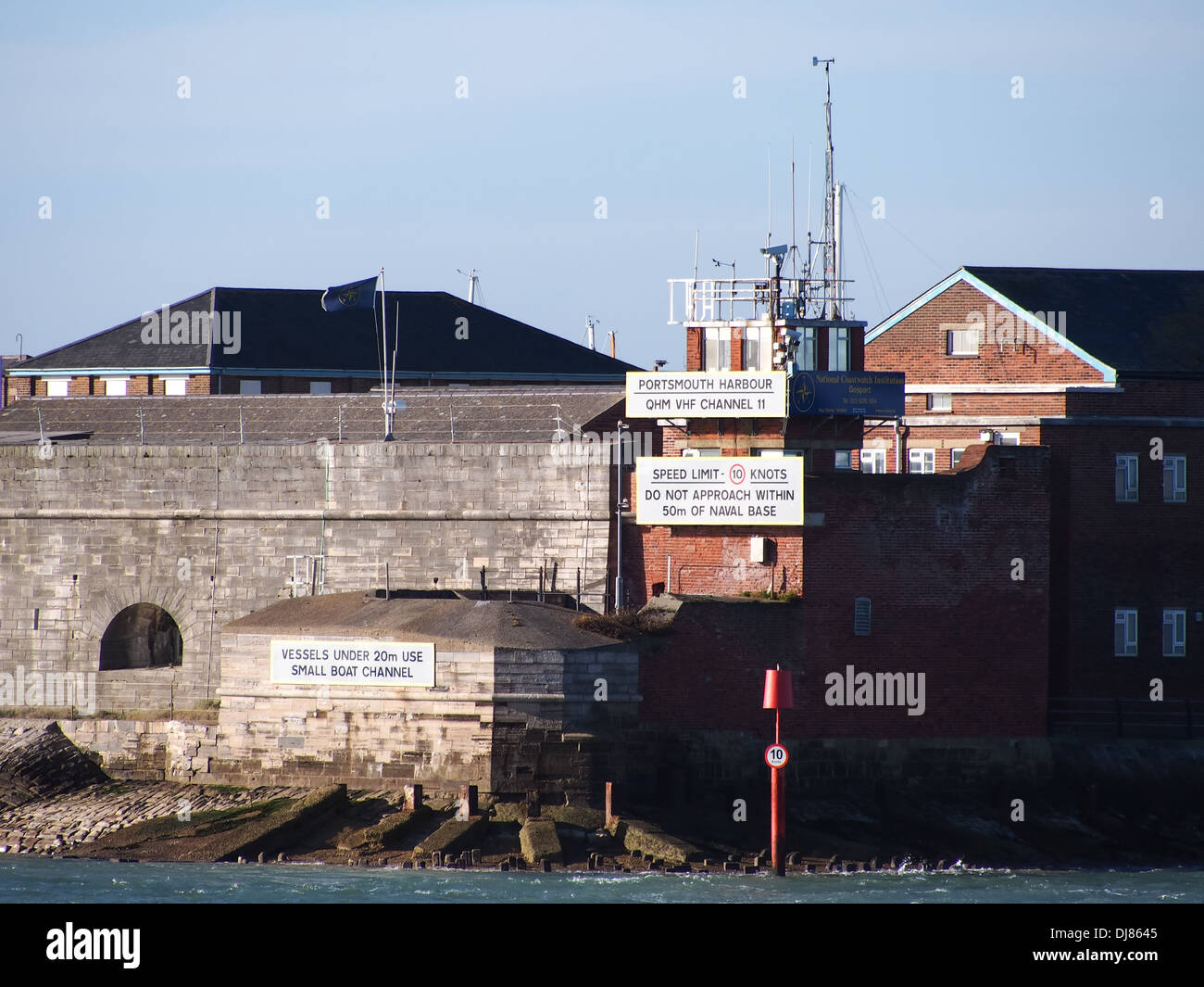The perimeter wall of  Fort Blockhouse and The entrance to Portsmouth Harbour with instructions for shipping - Stock Image