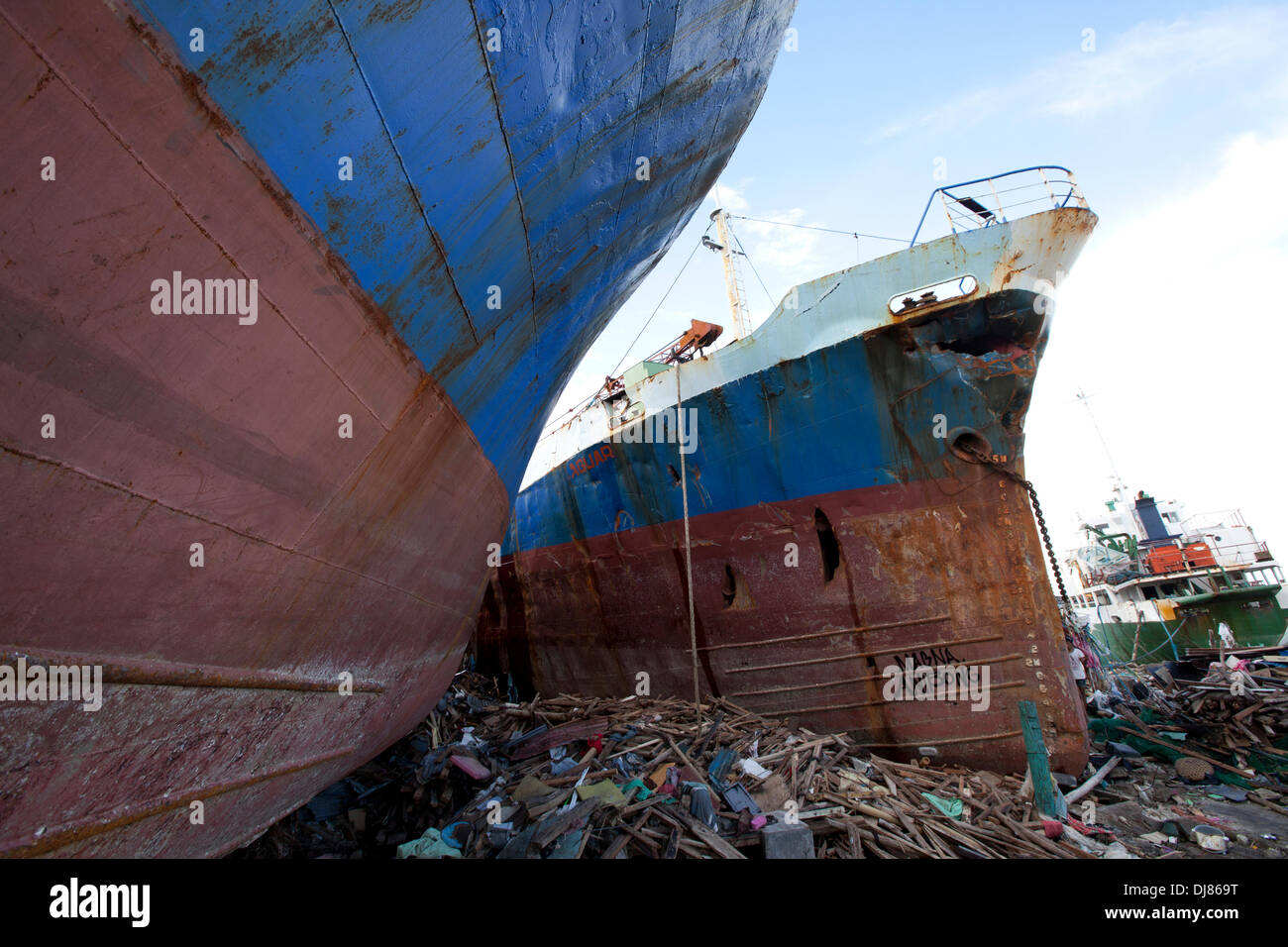 The extreme power of the storm surge accompanying Typhoon Haiyan/Yolanda devastated communities near to the Port area of Tacloban City.Cargo ships at anchor nearby were simply lifted and dumped onto land. - Stock Image