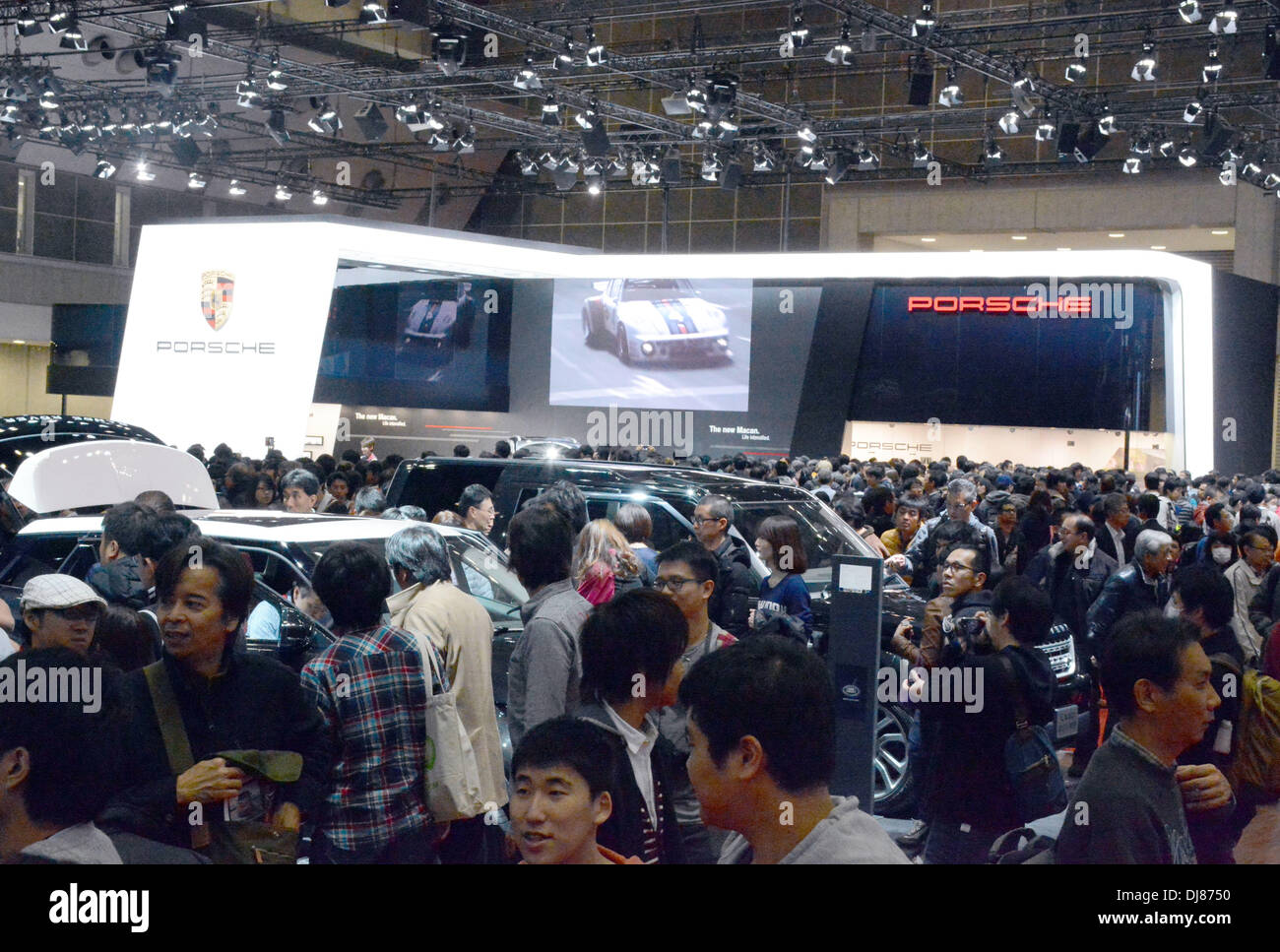 Tokyo, Japan. 23rd Nov, 2013. A huge crowd throngs around showpieces as the 43rd Tokyo Motor Show opens to the general public on Saturday, November 23, 2013, at Tokyo Big Sight. About 13,5800 people visited on the first day of the 10-day extravaganza, which showcases Japanese automakers' latest electronic technology and eco-friendly cars aimed at the growing low-emissions sector. Credit:  Kaku Kurita/AFLO/Alamy Live News - Stock Image