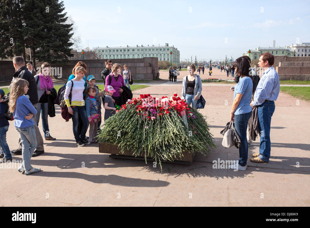 Red carnations around the eternal flame at the Field of Mars in St. Petersburg. Russia. Victory Day, May 9 - Stock Image