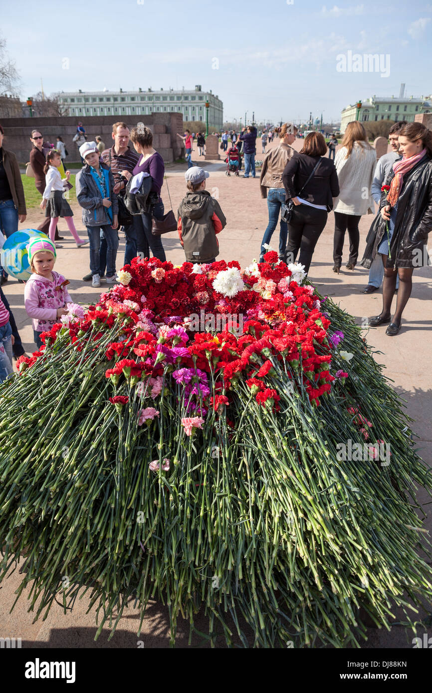 Red carnations around the eternal flame at the Champ de Mars in St. Petersburg. Russia. Victory Day, May 9 - Stock Image