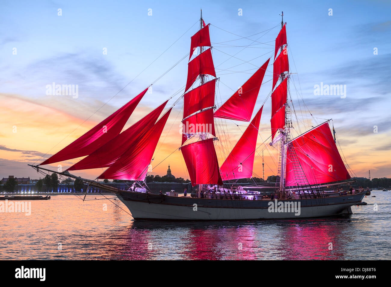 Celebration Scarlet Sails show during the White Nights Festival, St. Petersburg, Russia. Vessel over sunset sky - Stock Image