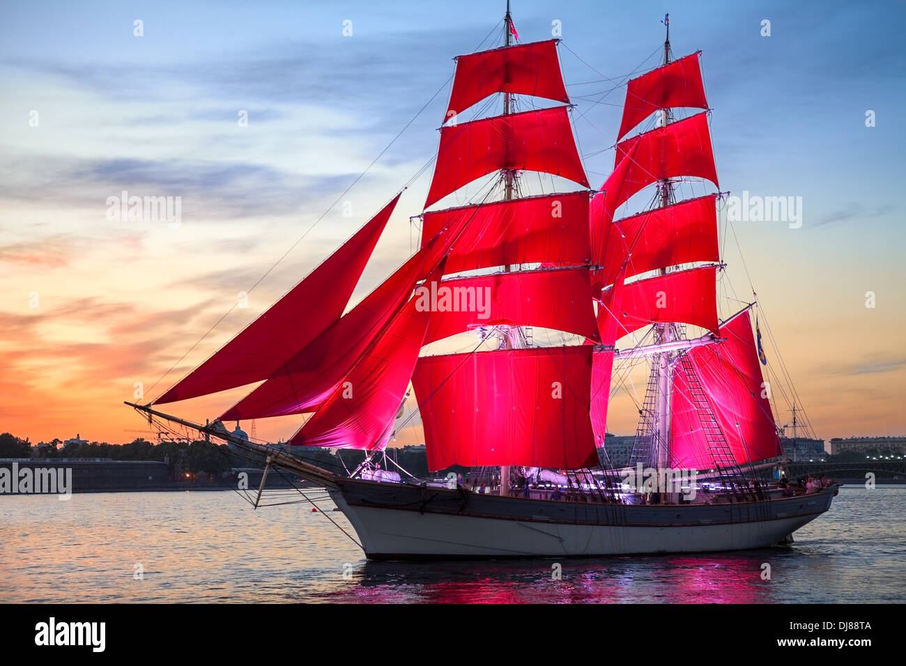 Celebration Scarlet Sails show during the White Nights Festival, St. Petersburg, Russia. Ship over sunset sky - Stock Image