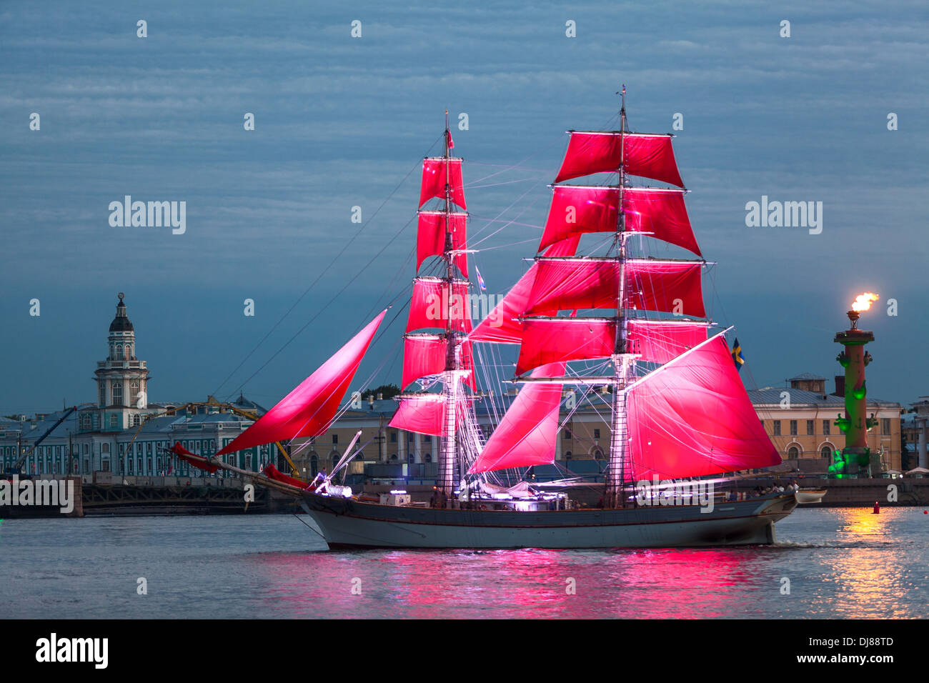 Celebration Scarlet Sails show during the White Nights Festival, St. Petersburg, Russia. Rostral Columns with fire - Stock Image