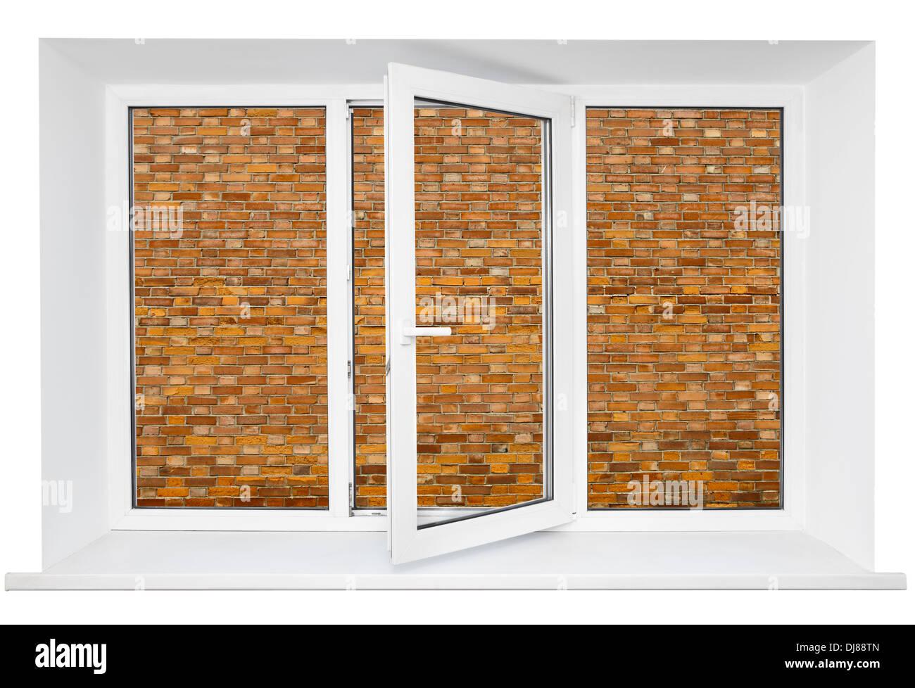 White plastic cutout triple door window with brick wall inside Stock Photo